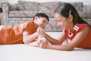 Boy and Girl Arm Wrestling