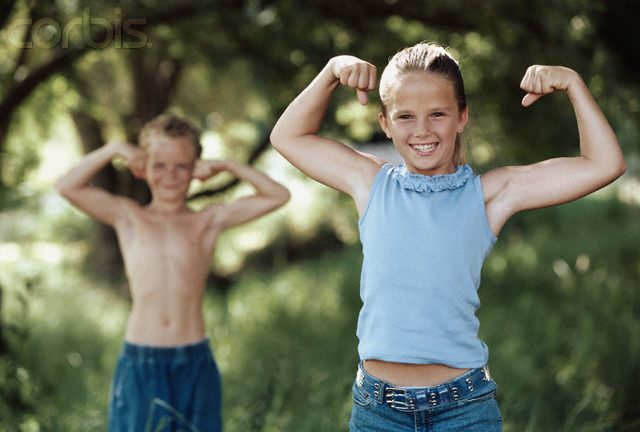 Healthy Children Flexing Their Muscles --- Image by © Corbis