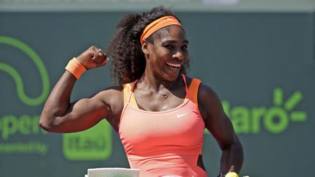 Serena Williams poses with cake celebrating her 400th career win after she defeated Sabine Lisicki during their quarterfinal match at the Miami Open tennis tournament, Wednesday, April 1, 2015, in Key Biscayne, Fla. Williams won the match 7-6 (4), 1-6, 6-3. (AP Photo/Lynne Sladky)