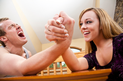 man-and-woman-arm-wrestle