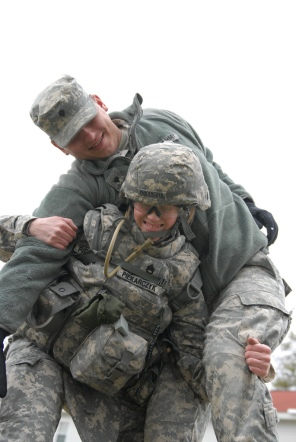 """Staff Sgt. Stephanie Piekarczyk of the Non-Commissioned Officers Academy at Fort Dix, N.J., demonstrates a """"fireman's carry"""" during the Warrior Task Training phase of the 2011 Regional Army Reserve Best Warrior Competition May 3 here."""