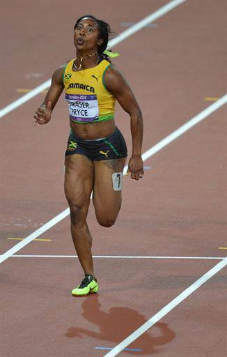 Jamaica's Shelly-Ann Fraser-Pryce competes to win the women's 100m final at the athletics event of the London 2012 Olympic Games on August 4, 2012 in London. AFP PHOTO / BEN STANSALL