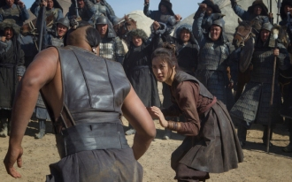 "Uli Latukefu (L) and Claudia Kim (R) in a scene from Netflix's ""Marco Polo."" Photo Credit: Phil Bray for Netflix."