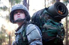 A soldier patrols through the woods during a field training exercise.