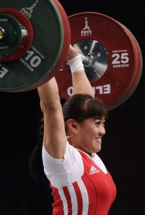 Kazakhstan's Maiya Maneza competes during the 2011 World Weightlifting Championships' finals in the 63 kg women's weight class on November 8, 2011 in Chessy, eastern suburb of Paris. AFP PHOTO / BERTRAND GUAY (Photo credit should read BERTRAND GUAY/AFP/Getty Images)