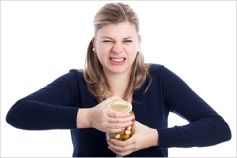 woman-struggling-to-open-jar-horiz_wztx2m