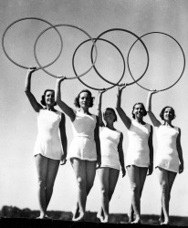 Volume 2, Page 24, Picture 10, 1936 Olympic Games, Berlin, Germany, Five young women take part in a display of the Olympic Rings (Photo by Popperfoto/Getty Images)