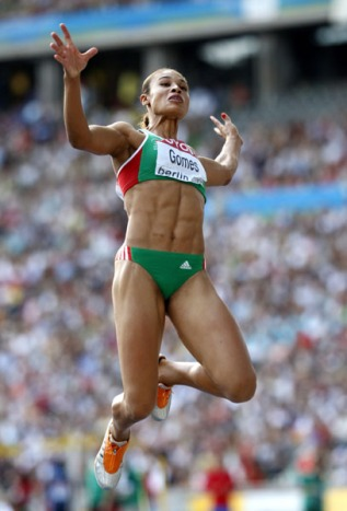 epa01835215 Naide Gomes of Portugal competes in the Long Jump final at the 12th IAAF World Championships in Athletics, Berlin, Germany, 23 August 2009. EPA/ROBERT GHEMENT