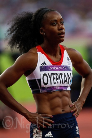 04 AUG 2012 - LONDON, GBR - Abi Oyepitan (GBR) of Great Britain watches the video replay of the first women's 100m semi final at the London 2012 Olympic Games athletics at the Olympic Stadium in the Olympic Park, Stratford, London, Great Britain (PHOTO (C) 2012 NIGEL FARROW)