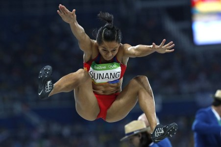 Philippines' Marestella Sunang competes in the Women's Long Jump Qualifying Round during the athletics event at the Rio 2016 Olympic Games at the Olympic Stadium in Rio de Janeiro on August 16, 2016. / AFP PHOTO / Adrian DENNIS