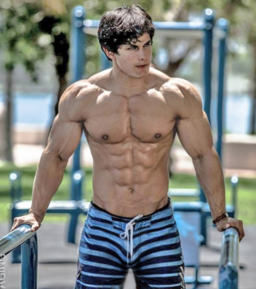 look_at_those_shoulders__by_builtbytallsteve-d6e0n4j