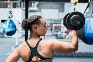 619-09060545 © Masterfile Royalty-Free Model Release: Yes Property Release: Yes Black woman lifting dumbbell in gymnasium