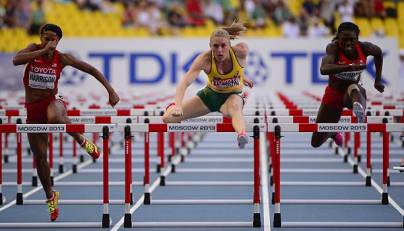 (L-R) US Queen Harrison, Australia's Sally Pearson and US Dawn Harper compete during the women's 100 metres hurdles semi-final at the 2013 IAAF World Championships at the Luzhniki stadium in Moscow on August 17, 2013. AFP PHOTO / OLIVIER MORIN (Photo credit should read OLIVIER MORIN/AFP/Getty Images)