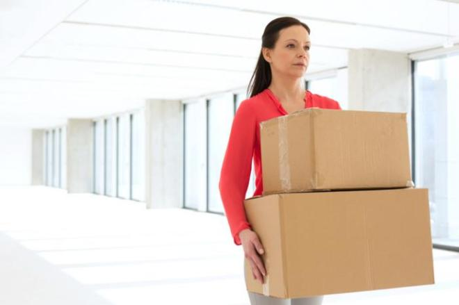 woman-carrying-heavy-boxes