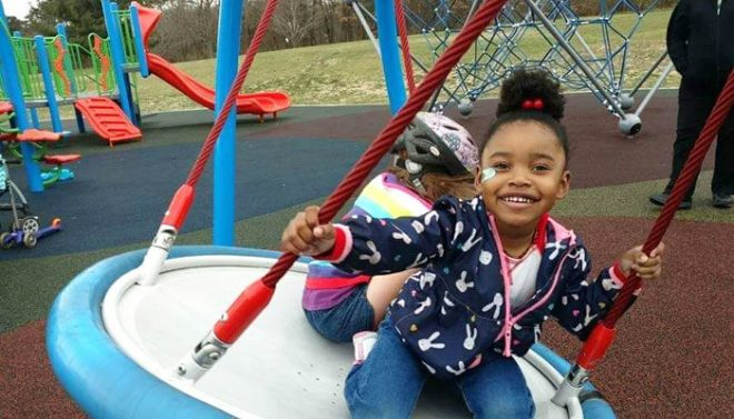 Cascade-Township-Park-feature-image-girl-swing-700x400
