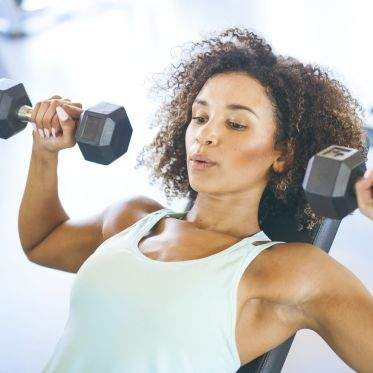 young-woman-weightraining-at-the-gym-royalty-free-image-874837090-1561132608