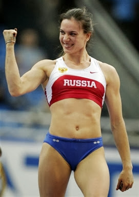 Russia's Yelena Isinbayeva celebrates after a jump during the final of the women's pole vault final at the 11th IAAF World Indoor Championships in Moscow 11 March 2006. Russia's Yelena Isinbayeva won the event ahead of Poland's Anna Rogowska and Russia's Svetlana Feofanova. AFP PHOTO ALEXANDER NEMENOV