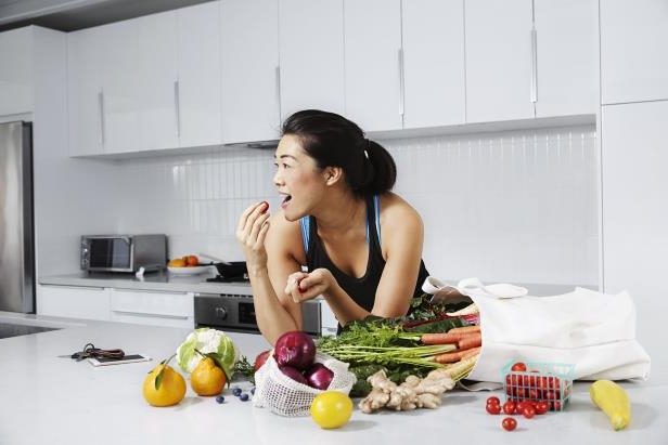 a-woman-sitting-at-a-table-eating-food-photographer-cera-hensleyeditorial-and-internal-use-approved-_121356_.jpg