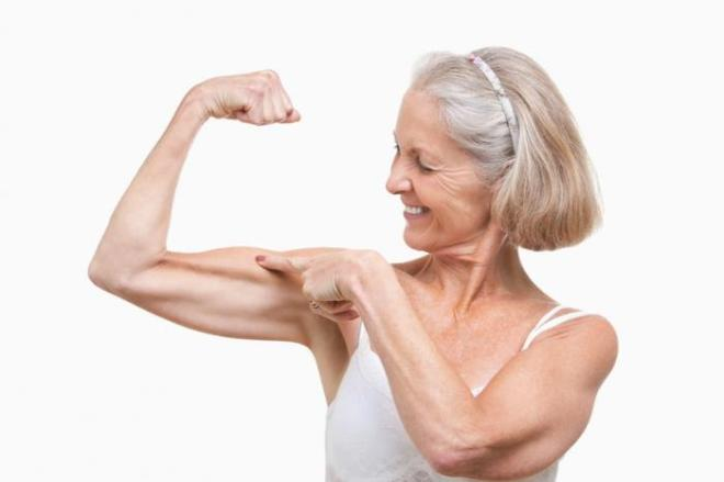 elderly-woman-showing-off-her-muscles