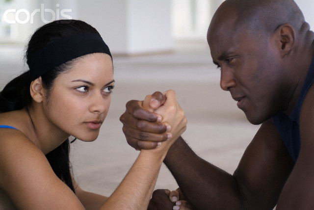 Man and woman arm wrestling, close-up